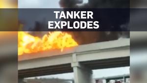 Fuel tanker explodes on highway overpass
