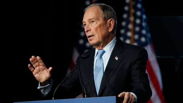 Wounded but defiant, Bloomberg promises to keep fighting