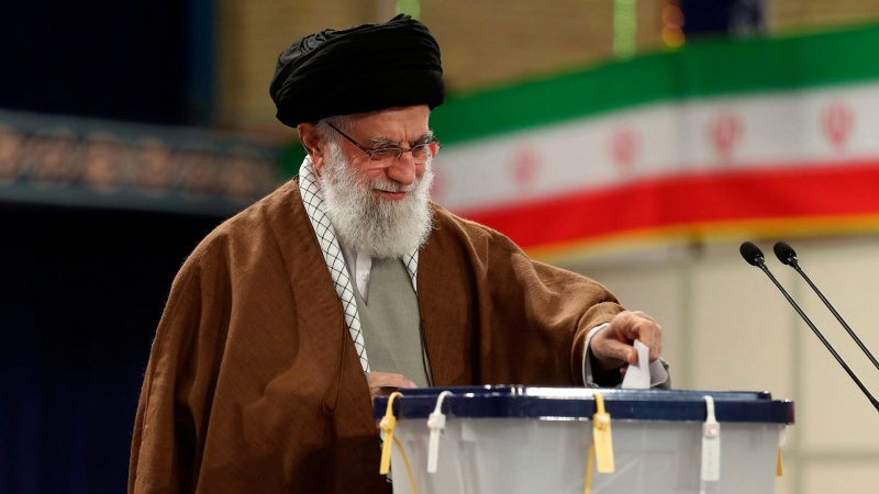 In this photo released by the official website of the office of the Iranian supreme leader, Supreme Leader Ayatollah Ali Khamenei casts his ballot in the parliamentary elections, in Tehran, Iran, Friday, Feb. 21, 2020. (Office of the Iranian Supreme Leader via AP)