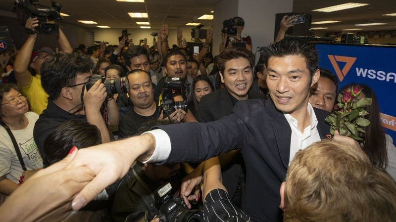 Thailand's Future Forward Party leader Thanathorn Juangroongruangkit shakes hands with supporters at the party's headquarters in Bangkok, Thailand, Tuesday, Jan. 21, 2020. (AP Photo/Sakchai Lalit)