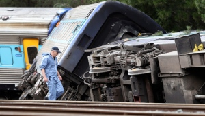 Cars of a passenger train are derailed in Wallan, Victoria, Australia, Friday, Feb. 21, 2020. (David Crosling/AAP Image via AP)