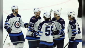 Winnipeg Jets centre Mark Scheifele (55) celebrates his third of three power-play goals against the Ottawa Senators with teammates right wing Logan Shaw (38), defenceman Josh Morrissey (44), centre Nicholas Shore (21) and left wing Gabriel Bourque (57) during third period NHL action in Ottawa on Thursday, Feb. 20, 2020. THE CANADIAN PRESS/Fred Chartrand