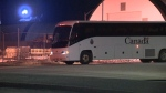 Buses carried Canadian evacuees from Japan to a hotel in Cornwall, Ont. for a second round of quarantine.