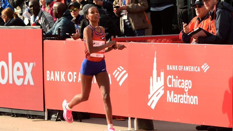 Ababel Yeshaneh of Ethiopia, finishes second during the women's portion of the Chicago Marathon Sunday, Oct. 13, 2019, in Chicago. (AP Photo/Paul Beaty)