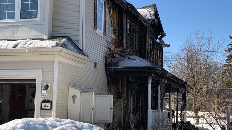 The aftermath of a two-alarm blaze at a row home in Barrhaven early Friday, Feb. 21, 2020. (Peter Szperling/CTV Ottawa)