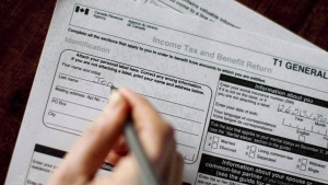 A T1 General 2010 tax form is pictured in Toronto on April 13, 2011. The tax rules are changing in 2016 and even if Canadians don't make enough to be hit by the new top federal income tax rate, their financial plans are going to need to be reviewed. (THE CANADIAN PRESS/Chris Young)