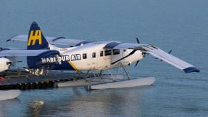 A Harbour Air plane is seen with damage to its wing. Police say a man stole a float plane then fled after crashing it into another plane.