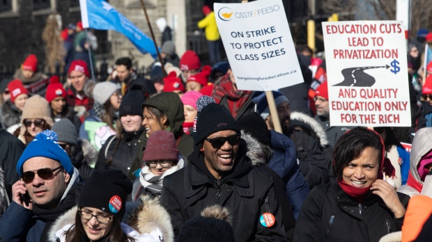 Protesters join a demonstration organized by the teacher's unions outside the Ontario Legislature in Toronto, as four unions hold a province wide education strike, on Friday, February 21, 2020. THE CANADIAN PRESS/Chris Young