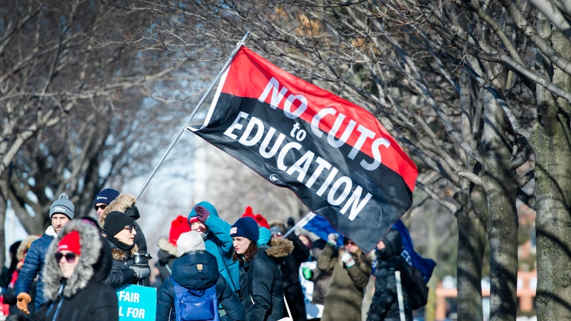Approximately 20,000 teachers from the Peel District School Board hold a one day strike in Mississauga, Ont., on Friday, February 21, 2020. The Guinness Book of World Records has been notified as some believe it could be the longest picket line of all time. (Nathan Denette/The Canadian Press)