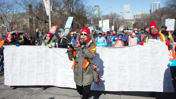 Protesters join a demonstration organized by the Teacher's Unions outside the Ontario Legislature, in Toronto, as four Teacher's Unions hold a province wide education strike, on Friday, February 21, 2020. (Chris Young/The Canadian Press)