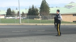 RCMP officers armed with rifles are currently on the streets near the schools. (CTV News)