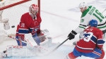 Dallas Stars' Jason Dickinson (18) moves in on Montreal Canadiens goaltender Carey Price as Canadiens' Victor Mete (53) defends during second period NHL hockey action in Montreal, Saturday, February 15, 2020. THE CANADIAN PRESS/Graham Hughe
