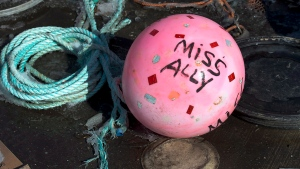 A buoy from the fishing boat Miss Ally rests on the dock in Woods Harbour, N.S. on Tuesday, Feb. 19, 2013.  (THE CANADIAN PRESS/Andrew Vaughan)