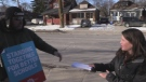Parents hand childcare compensation to teachers in London.
