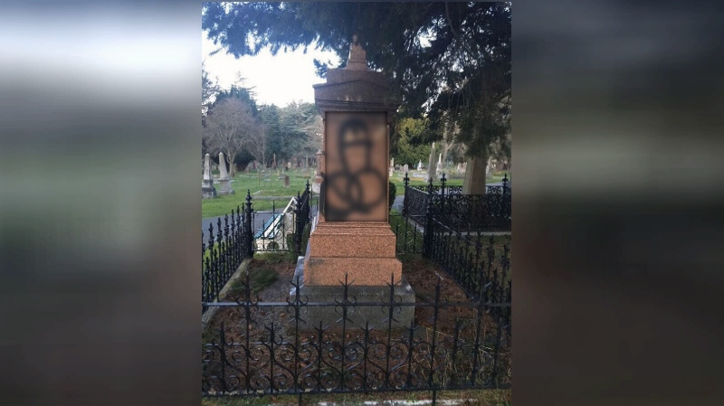 City officials say the graffiti was discovered on the grave marker, a tree and a nearby office building, early Thursday morning. (Old Cemeteries Society/Facebook)