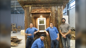 Inmates at Stony Mountain Institution stand beside the parking kiosk they built for Festival du Voyageur. (Source: Facebook/Correctional Service of Canada)