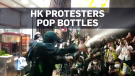 Protesters pop champagne after officer contracts v