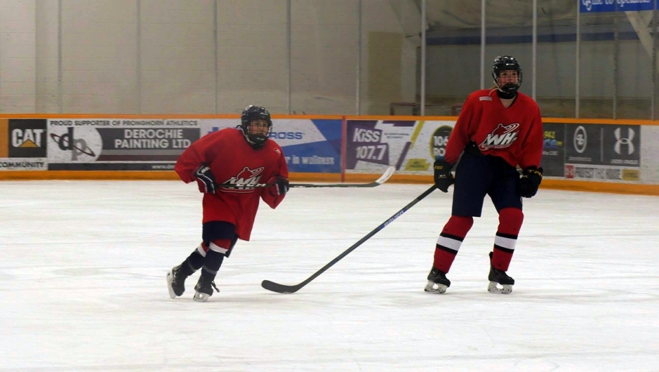 Lethbridge Bantam AAA hockey player Kendal Davidson (R), hopes to play in the WHL.