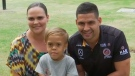 In this photo taken from video provided by Australian Broadcasting Corporation, Quaden Bayles, center, his mother, Yarraka Bayles, and Cody Walker, a professional rugby league player, pose together Friday, Feb. 21, 2020, in Gold Coast, Australia. (Australian Broadcasting Corporation via AP)