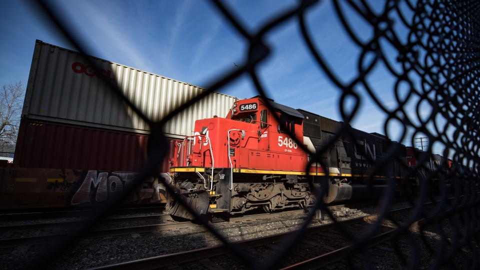 In this file photo, CN Rail locomotives are moved on tracks past cargo containers sitting on idle train cars at port in Vancouver, on Friday, February 21, 2020. THE CANADIAN PRESS/Darryl Dyck