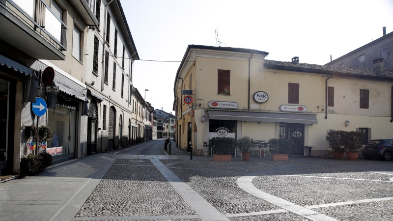 A deserted road in the town of Codogno, near Lodi, Northern Italy, Saturday, Feb. 22, 2020. (AP Photo/Luca Bruno)