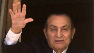 In this April 25, 2016 file photo, ousted Egyptian President Hosni Mubarak waves to his supporters from his room at the Maadi Military Hospital, where he was hospitalized, in Cairo, Egypt. (AP Photo/Amr Nabil, File)