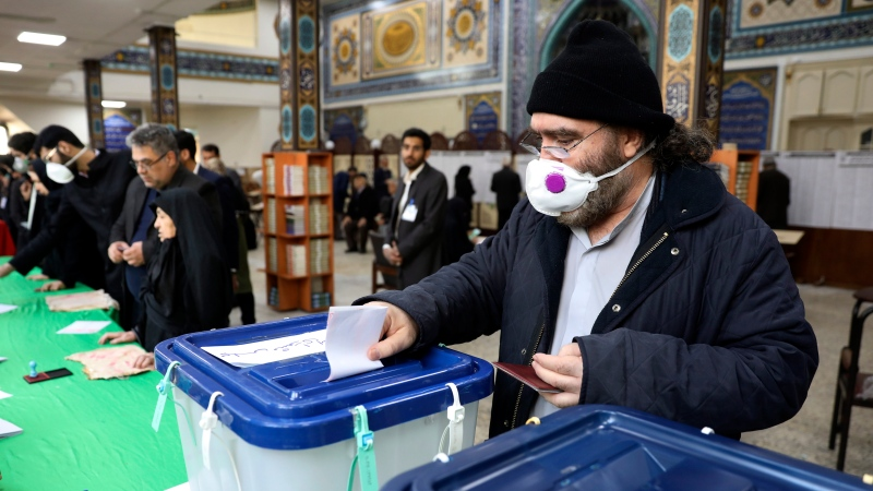 A voter casts his ballot in the parliamentary elections in a polling station in Tehran, Iran, Friday, Feb. 21, 2020. (AP Photo/Vahid Salemi)