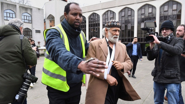 Stabbing victim Muslim prayer leader Raafat Maglad arrives at the London Central Mosque after being released from hospital, Friday Feb. 21, 2020. (Kirsty O'Connor/PA via AP)