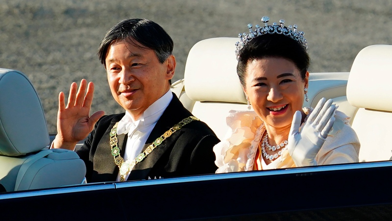 In this Nov. 10, 2019, file photo, Japanese Emperor Naruhito, left, and Empress Masako wave during the royal motorcade in Tokyo. Emperor Naruhito turns 60 years old Sunday, Feb. 23, 2020. (AP Photo/Eugene Hoshiko)