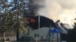 Firefighters work to extinguish a fire at Harvesters Baptist Church in London, Ont.