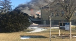 Building attached to Harvesters Baptist Church destroyed by fire.