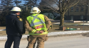 Fire chiefs from London and Middlesex monitor the situation as fire ravages a building at Harvester Baptist Church. (Brent Lale / CTV London)