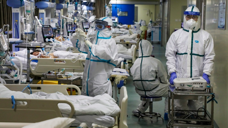 Medical workers treat patients in the isolated intensive care unit at a hospital in Wuhan in central China's Hubei province Thursday, Feb. 6, 2020. (Chinatopix via AP)
