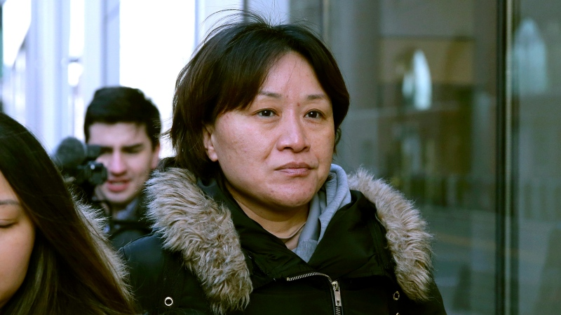 Xiaoning Sui, a Chinese national residing in Surrey, B.C., leaves federal court, Friday, Feb. 21, 2020, in Boston, after pleading guilty to paying $400,000 to get her son into the University of California, Los Angeles, as a fake soccer recruit. (AP Photo/Charles Krupa)