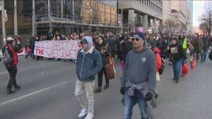 People are marching down University Avenue in support of the Wet'suwet'en hereditary chiefs.