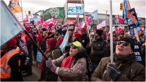 Members of the Ontario Federation of Labour protest outside the Scotiabank Convention Centre during the Ontario Progressive Conservative party 2020 policy convention in Niagara Falls, Ont. on Saturday, February 22, 2020. THE CANADIAN PRESS/ Tijana Martin
