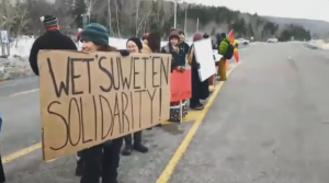 Holding signs and handing out information papers, those at the protest say some Canadians are very unaware of the issues First Nations people are facing.(SOURCE:FACEBOOK/RIPPLE FX CANADA)