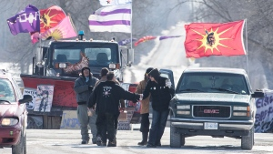 Supporters shake hands with protesters in Tyendinaga, near Belleville, Ont., on Saturday Feb.22, 2020, at the railway blockade in support of the Wet'suwet'en who oppose work on a pipeline in northern B.C. THE CANADIAN PRESS/Lars Hagberg