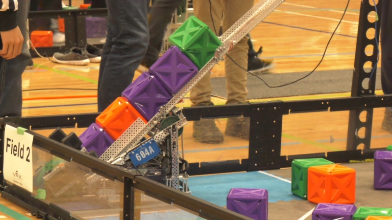 The game involves stacking 14-centimetre cubes using semi-autonomous robots constructed and programmed without any specific instructions for how to do so. (CTV)