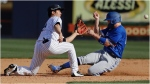 New York Yankees' Hoy Jun Park, left, of South Korea, tags out Toronto Blue Jays' Patrick Kivlehan, right, during the eighth inning of a baseball game Saturday, Feb. 22, 2020, in Tampa. (AP Photo/Frank Franklin II)