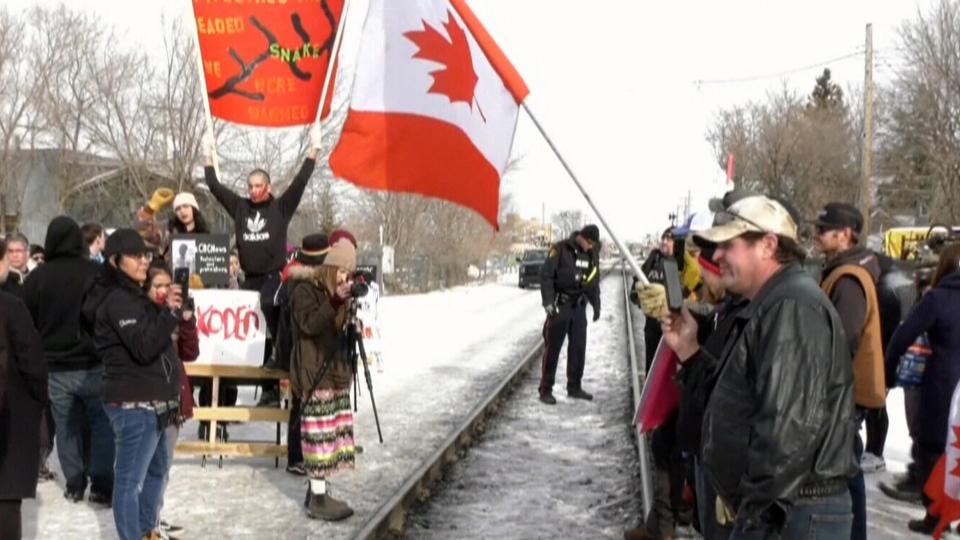 Protesters block a railroad in Saskatoon on Saturday, Feb. 22, 2020.