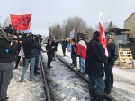 Wet'suwet'en protesters and a group of counter-protesters clashed along a Saskatoon rail line on Saturday. (Chad Leroux/CTV News)