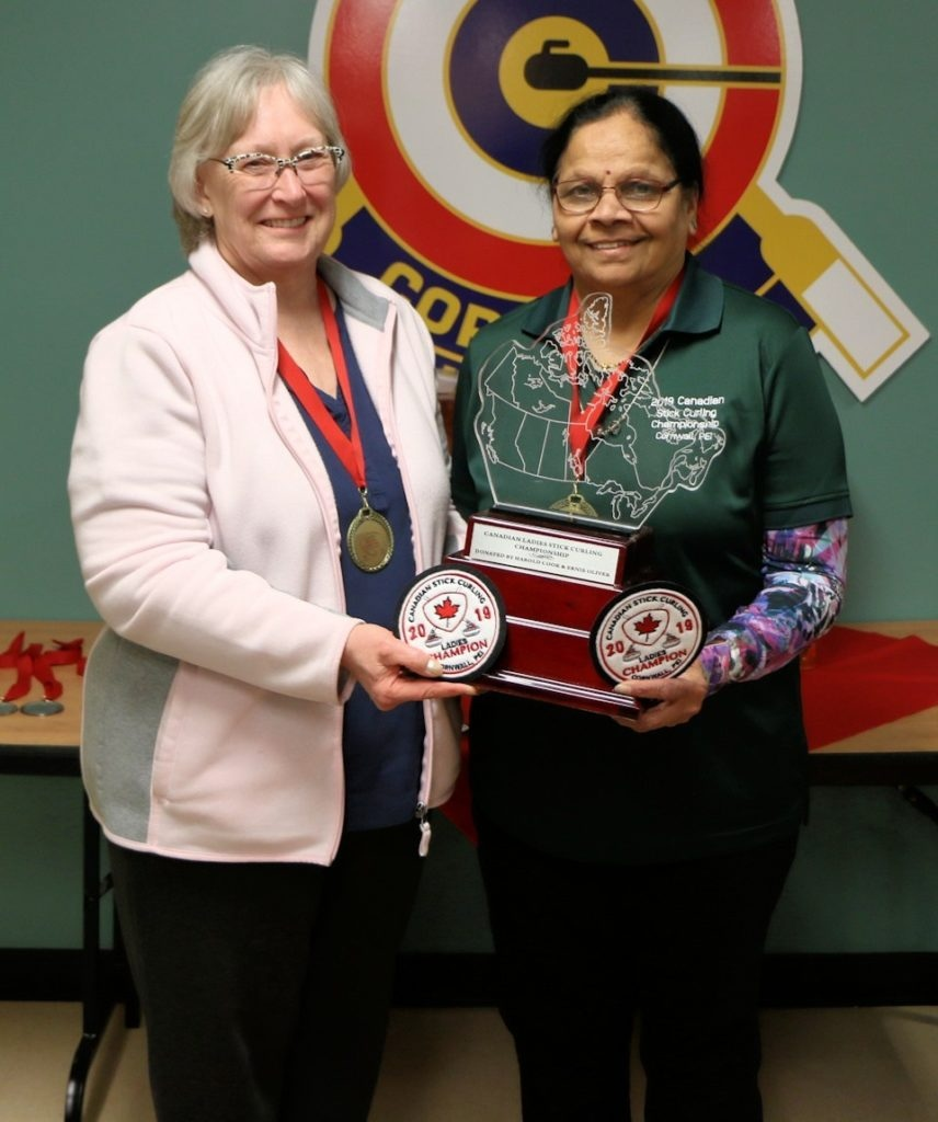 Uttara Despande and Sandra Walker posing as 2019 Canadian Women's Stick Curling Champions in Cornwall, P.E.I. (Source: Canadianstickcurling.ca)