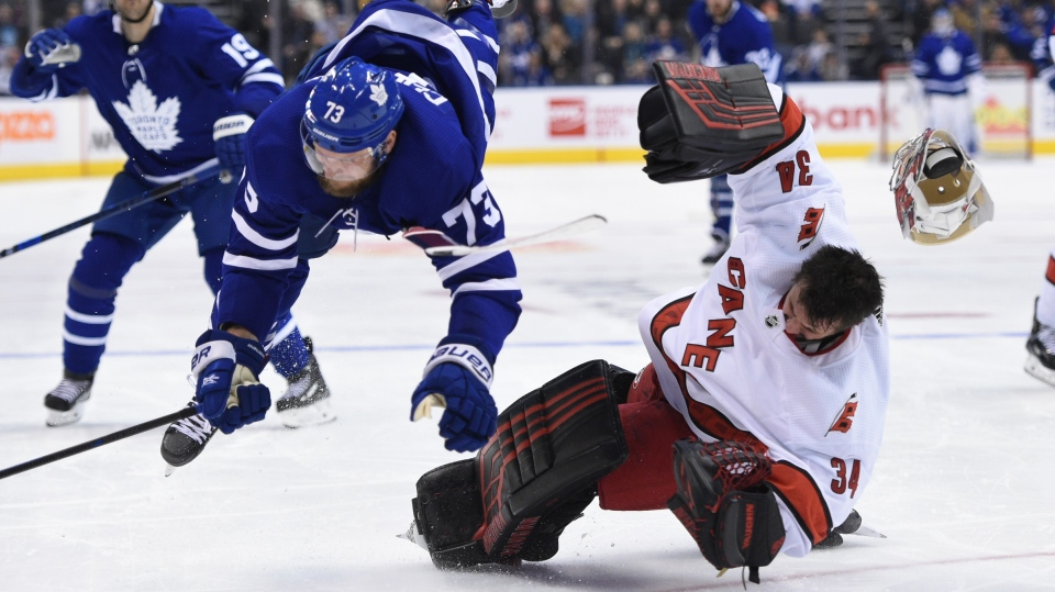 Carolina Hurricanes goaltender Petr Mrazek (34) hits the ice after Toronto Maple Leafs left wing Kyle Clifford (73)skates into him during second period NHL hockey action in Toronto, Saturday, Feb. 22, 2020. Mrazek left the game. THE CANADIAN PRESS/Frank Gunn