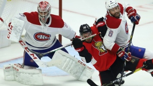 Ottawa Senators centre Colin White (36) attempts to deflect the puck as Montreal Canadiens defenceman Ben Chiarot (8) defends in front of Canadiens goaltender Carey Price (31) during first period NHL action in Ottawa on Saturday, Feb. 22, 2020. THE CANADIAN PRESS/Fred Chartrand