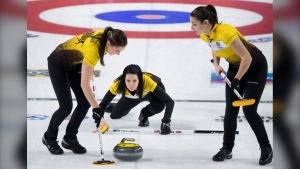 Team Manitoba skip, Kerri Einarson watches her shot as lead, Briane Meilleur and second, Shannon Birchard sweep during 1 vs 2 page playoff against team Wild Card at the Scotties Tournament of Hearts in Moose Jaw, Sask., Saturday, February 22, 2020. (THE CANADIAN PRESS/Jonathan Hayward)