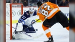 Winnipeg Jets' Connor Hellebuyck (37) blocks a shot by Philadelphia Flyers' Connor Bunnaman (82) during the second period of an NHL hockey game, Saturday, Feb. 22, 2020, in Philadelphia. (AP Photo/Matt Slocum)