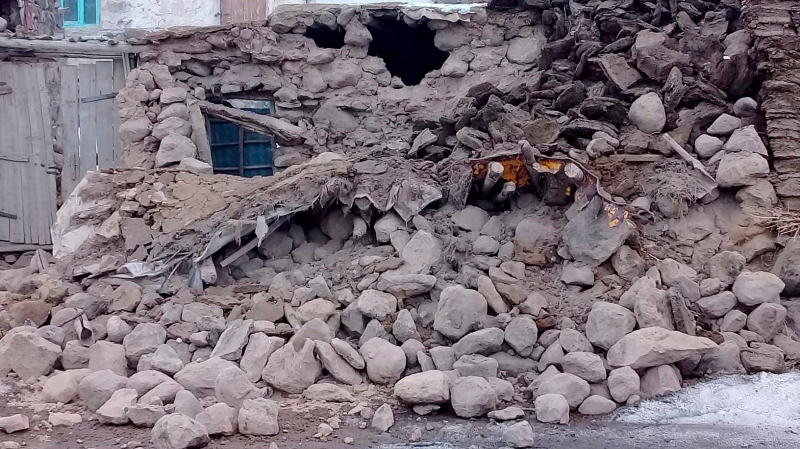 Houses are reduced to rubble after an earthquake hit villages in Baskale in Van province, Turkey, at the border with Iran, Sunday, Feb. 23, 2020. (IHA via AP)