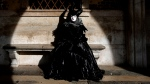 A woman wearing a carnival costume sits on a bench of the Palazzo Ducale during carnival celebrations in Venice, Italy, Sunday, Feb.16, 2020. (AP Photo/ Luca Bruno)