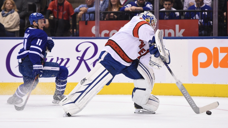 Hurricanes emergency goalie David Ayres comes out of his net to play the puck against the Toronto Maple Leafs during second period NHL hockey action in Toronto, Saturday, Feb. 22, 2020. Ayres, who serves as the Toronto Marlies' zamboni driver, replaced Petr Mrazek in net after a delay in action. THE CANADIAN PRESS/Frank Gunn